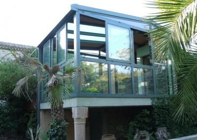 Véranda avec toiture cuivre / liège et verre à contrôle solaire