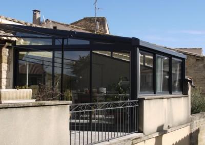 Véranda avec toiture vitrée totale à contrôle solaire